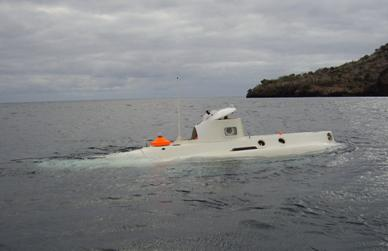 The submarine heads out to sea